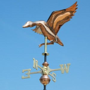 Polished copper weathervanes